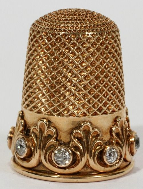 Late Victorian golden thimble with mine cut diamonds.