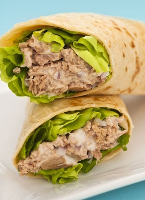 7. Tuna. Tuna is loaded with protein and heart healthy fats, so it's a great choice when hunger strikes during the day. Start with a large romaine lettuce leaf on a tortilla. Add a couple spoonfuls of canned tuna on the lettuce. Layer on matchstick carrots and cucumbers, season it with salt and pepper, then roll it up. This one is similar to a sushi roll, without all the creamy sauces that make it an unhealthy choice.