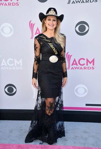 Lisa Lageschaar – Miss Rodeo America: Black dress by Becci Maloney (Bridle to Bridal), Hat (Greeley Hat Works) decorated with the Landstrom's Black Hills Gold Miss Rodeo America crown, Boots (Justin), accessories (Montana Silversmiths) | The 52nd Academy Of Country Music Awards at Toshiba Plaza on April 2, 2017 in Las Vegas, Nevada.