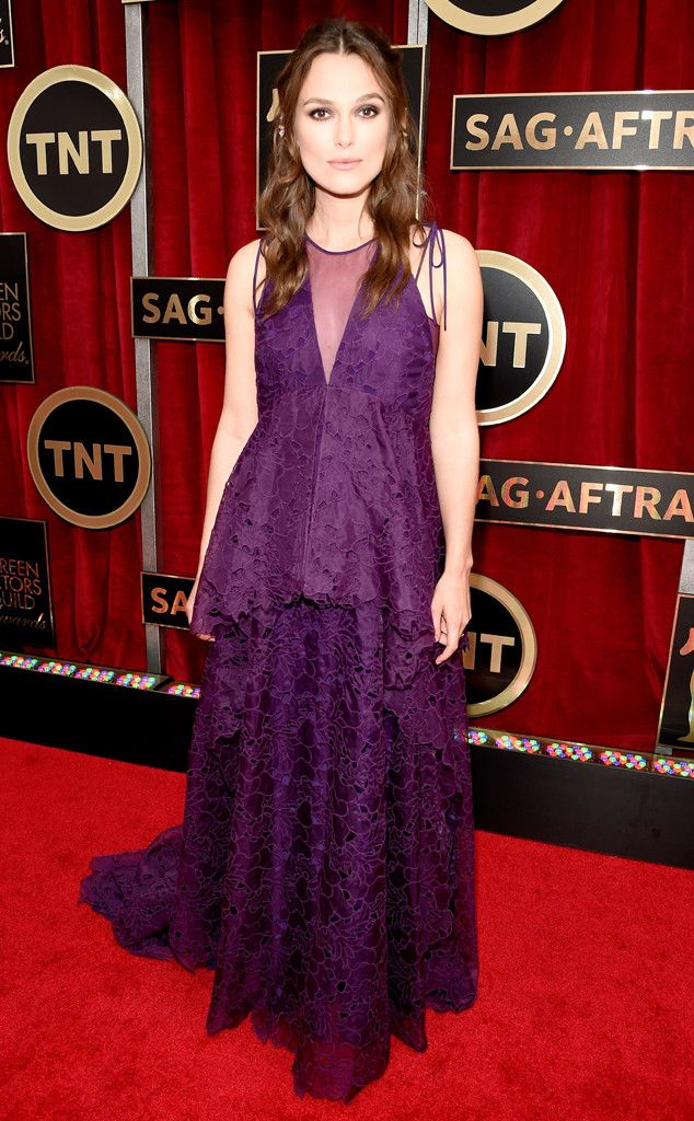 Keira Knightley covers her baby bump in a purple Erdem number!