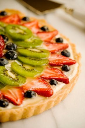 Paula Deen Fresh Fruit Tart-- and if you don't want to make the crust, you can you the premade Pillsbury sugar cookie dough, but if you do, be sure to carefully grease and dust the pan with flour before you put the cookie dough down... it is really sticky!!