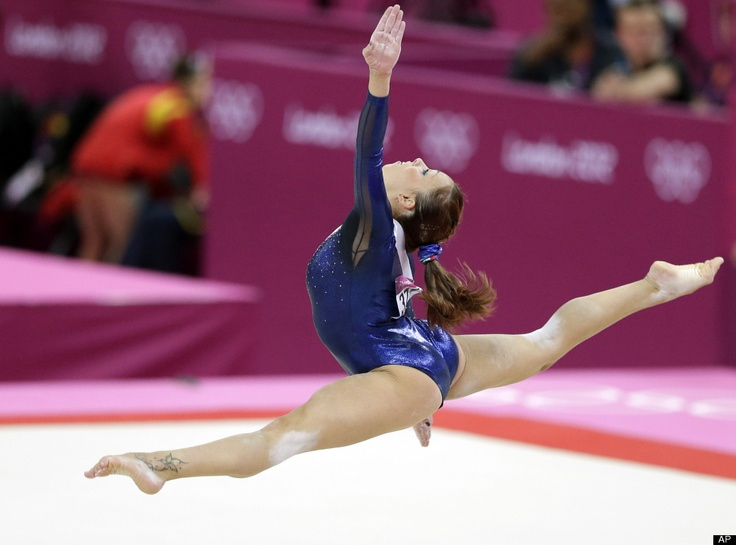 Stunning! Italian gymnast Vanessa Ferrari performs on the floor during the Artistic Gymnastic women's team final at the 2012 Summer Olympics, Tuesday, July 31, 2012, in London. (AP Photo/Gregory Bull) Strength = Beauty