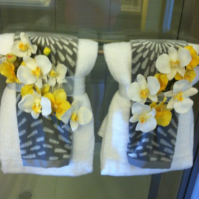 Bathroom Do You Know How To Decorate Bathroom Towels With Bautiful White And Yellow Flower In The White Towel Decoration Design Ideas For Your Bathroom In