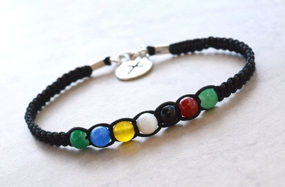 Mens salvation bracelet is made with black cord a metal cross charm and crystals that have a spiritual meaning. Can also be made with plain glass beads instead of crystals   Green- Promise of eternal life Blue- Gifts of the Spirit Gold- Heavens with streets of Gold Red- The blood of Christ Black- Sin Clear- Forgiveness