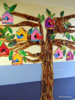 Spring bulletin board idea: Such a cute way to display these painted birdhouses!