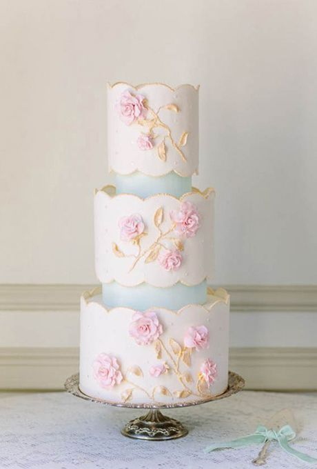 Brides.com: 32 of the Prettiest Floral Wedding Cakes. Scalloped-edge wedding cake with pink sugar flowers, by The Flour Garden.  See more vintage wedding cakes.