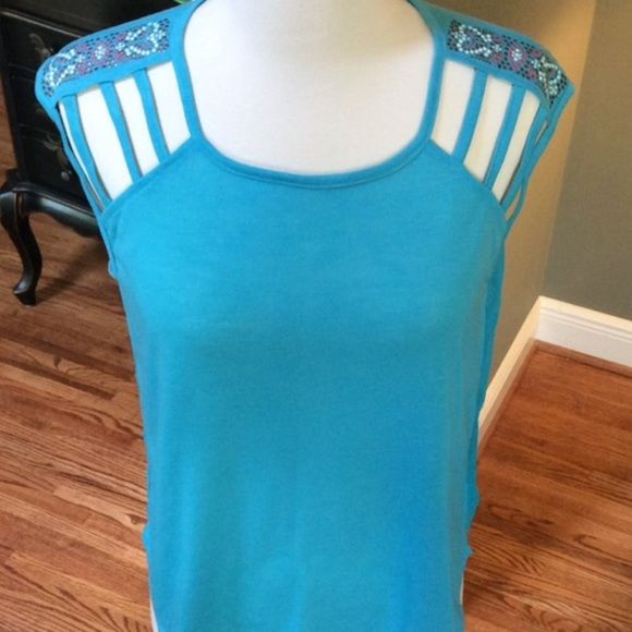 CLEARANCE EMBELLISHED TOP Gorgeous embellished mixed media tee in Blue Atoll. Love this top and the detail on the shoulders. There is adorable embellishment on top of shoulders! The front is knit and the back is almost sheer. Flirty and fun! Sizes available: M (1) L (2) Limited sizes and quantities so once they arrive be sure to comment your size needed! No PayPal No Trades Price is firm unless bundled. Tops