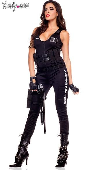 Terminator Jumpsuit Costume - The Terminator Jumpsuit costume is a five piece set that features a black zip front jumpsuit with leg pockets and Terminator printed on the leg along with a cartridge belt, a waist belt with leg gun holster, glasses and biker gloves. (Gun not included.)