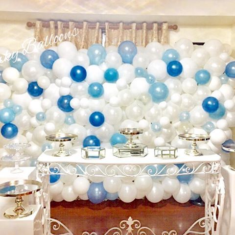 Balloon wall with whites and shades of blues