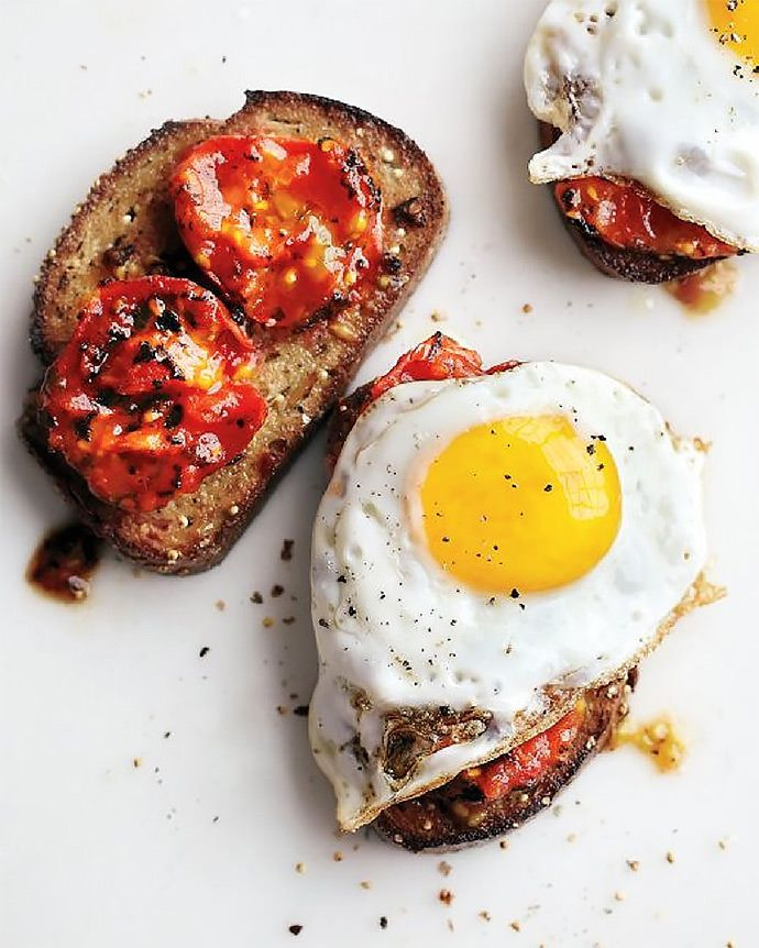 Breakfast Sandwich Recipe: Charred Tomatoes with Fried Eggs on Garlic Toast (via MarthaStewart.com)