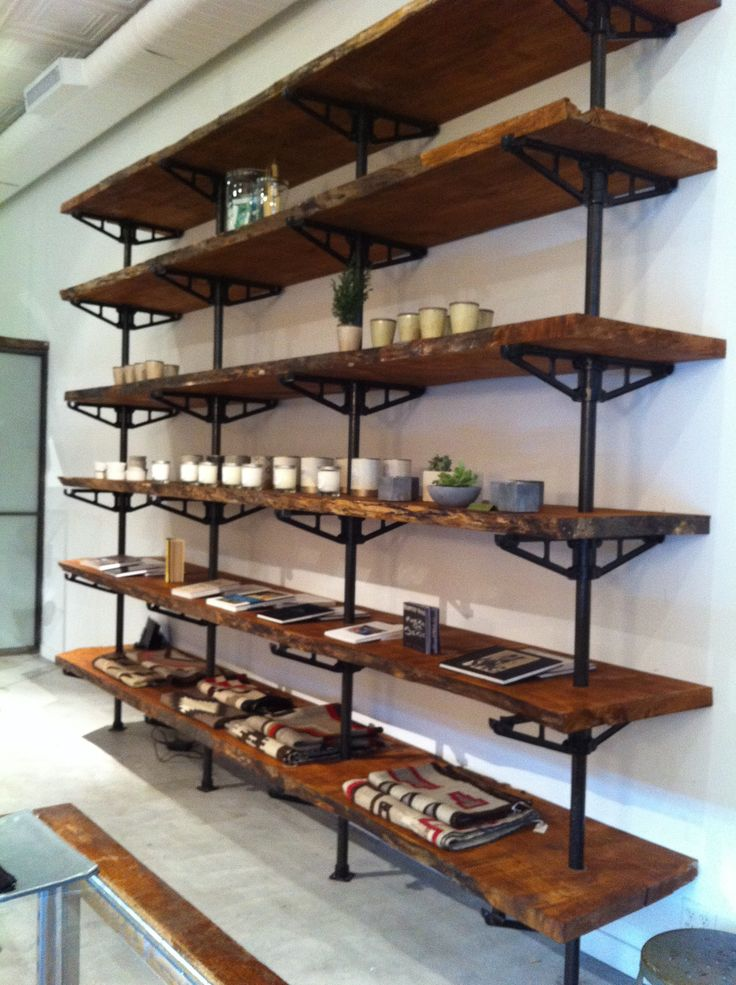 Great, Simple, adjustable shelving unit by Robert True Ogden... uses reclaimed wood planks and cast aluminum pipe fittings. Google Image Result for http://blog.loveadorned.com/wp-content/uploads/IMG_9731.jpg