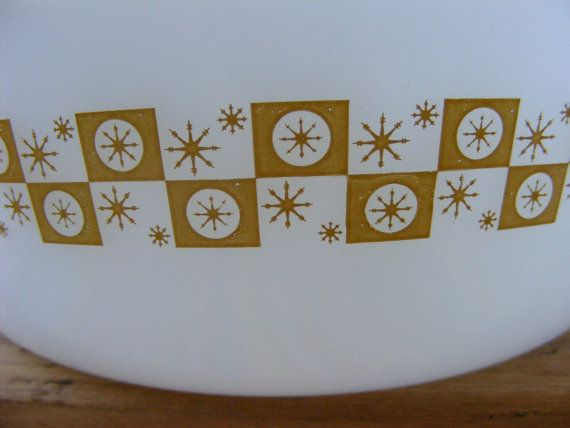Fire King Star Glow, Starburst casserole. This small mid-century Starburst dish has a gold check or checkerboard pattern on both sides. Although without a makers mark, all of the dishes that Ive seen in this pattern (and Ive never seen them in another colour) are thought to have been unmarked Fire King. Makes sense to me given that the scalloped handles are more prominent with FK than Federal or Hazel-Atlas. Cute bowl, cool graphics!  Matching custard cups available! https://www.ets...