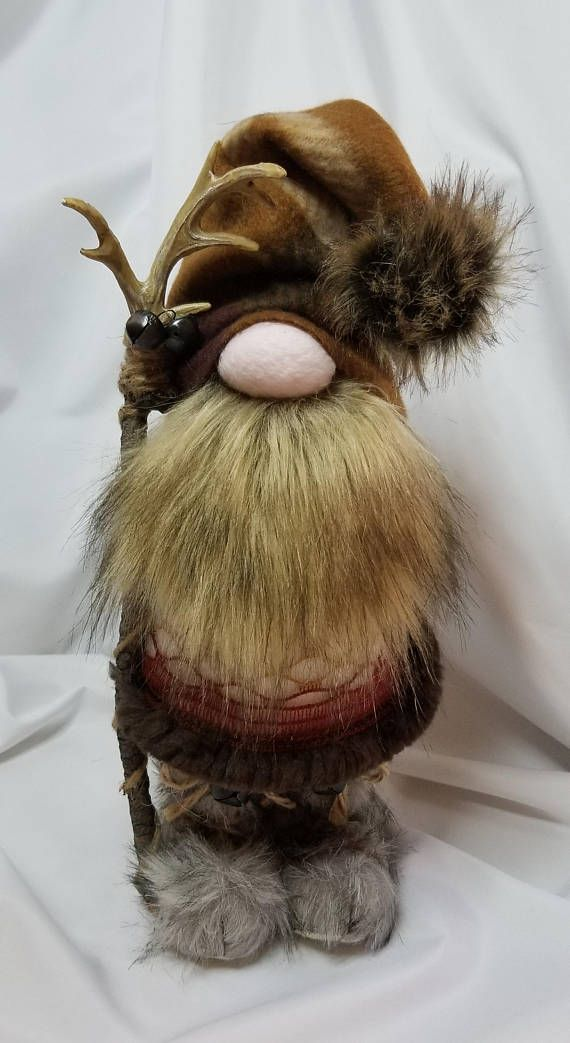 14 inches tall. Adorable, hand made with new materials. Felt/fleece fabric stuffed with polyester fiber fill and rice for weighted base. Each gnome is one of a kind, named, numbered and signed! Available in all holiday themes, occupational and traditional Nordic designs