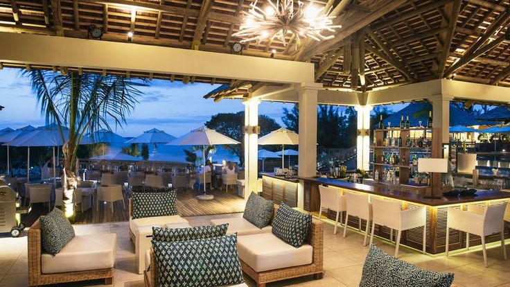 Rustic furniture from Yuni Bali furniture, polished wood floors, coconut fibre carpets, together with touches of bright colours help to ensure rooms blend perfectly with the surrounding nature at Zilwa Attitude Resort, Mauritius