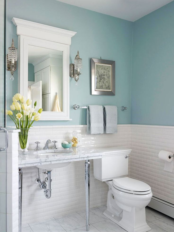 I would consider a light periwinkle blue with all white. Don't like the mirror or light fixtures, but do like the color/white contrast and all white fixtures.
