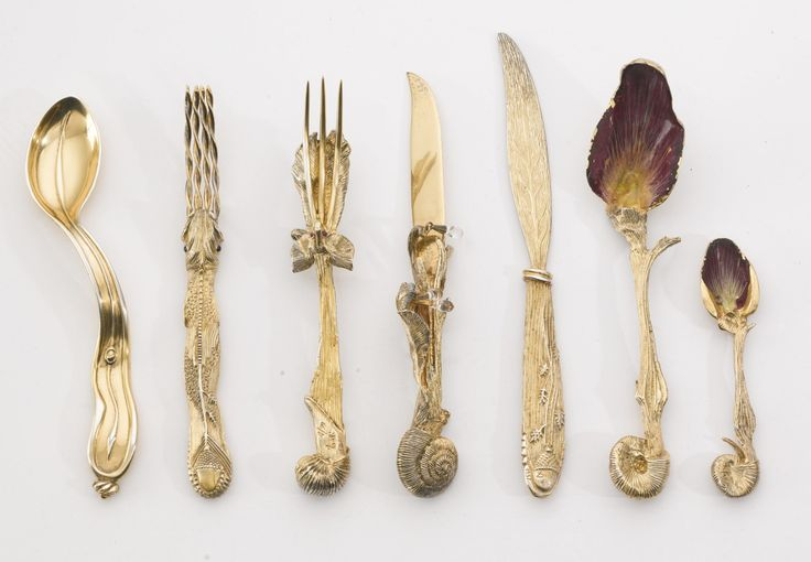 If the Geyser of Awesome staff got to sit down to a dream meal, it would be eaten using this phantasmagorical silver-gilt Ménagère (cutlery set) and Cuillère Montre Molle (soft watch spoon) created by Salvador Dalí in 1957.via devilduck: Ménagère (Cutlery Set) by Salvador Dali.Fourchette 4 dents à manche poisson (four tooth fork with a fish handle)Fourchette-éléphant 3 dents (elephant fork with three teeth)Couteau escargot aux larmes (snail knife with tears)Cocteau feuille (leaf…