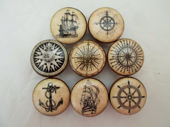 Set of 8 Old World Nautical print wood drawer knobs.  Set 1 is Photo 1 Set 2 is Photo 2   These wood knobs are 1.5 wide and have been stained English Chestnut with a decoupage nautical pattern. Sealed with a triple coat gloss finish so these knobs are durable enough for everyday use on your cabinets or furniture. Mounting screws included, these wood knobs feature a brass insert to ensure a secure fit when attaching the screws.