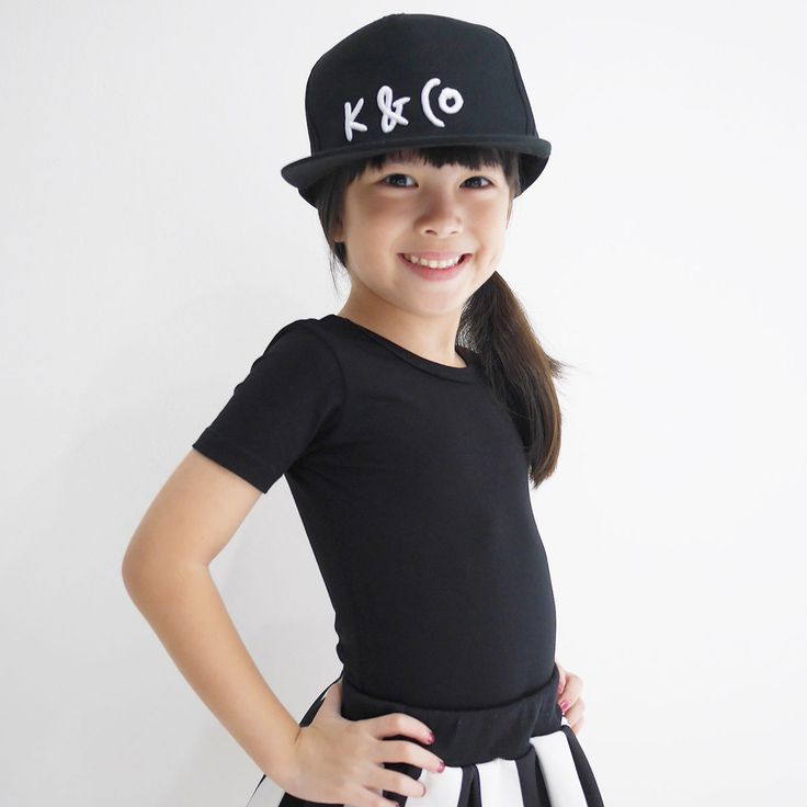 Kids K & Co Snapback | Hats on for the kids! Wear the innovative K & Co brand and let the world know how unique you truly are. Black cotton crown with a black polo brim. Typically minimal and unbelievably cool whatever age you are, wear our snapback hat and instant credibility is likely to come your way, whether you're out and about or just kicking about at home.  We recommend the Adult Snapback for bigger kids (aged 6+) | www.kidultand.co
