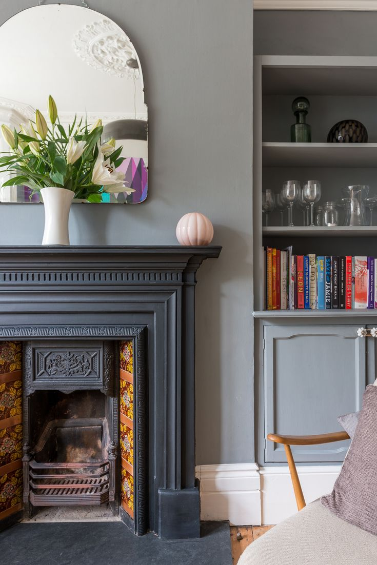 Little Greene Paint Company - Mid Lead with Black fireplace and vintage  40's mirror. Photos