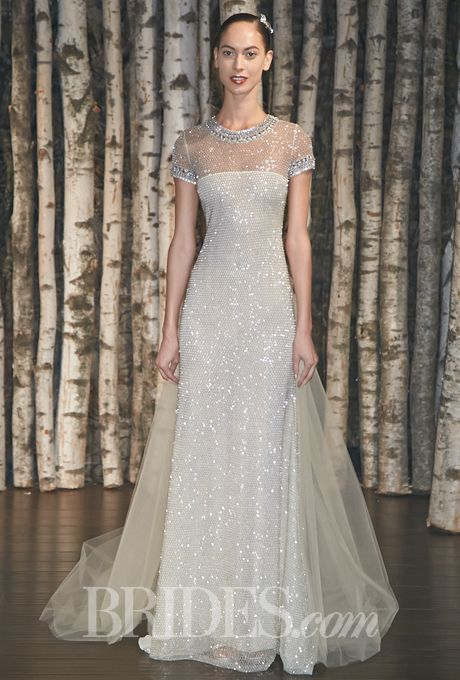 """Brides.com: Naeem Khan - Spring 2015. """"Rome"""" silver honeycomb beaded sheath wedding dress with a sheer neckline and crystal trim on the neck and short sleeves, Naeem Khan. Modest"""