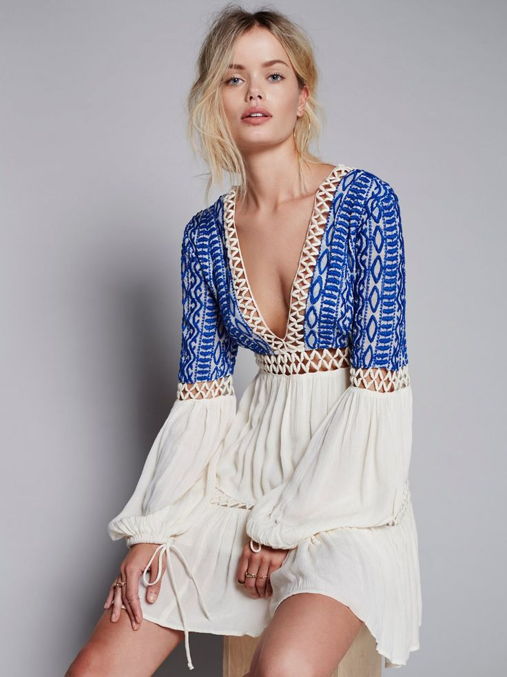 Dusk 'Til Dawn Mini | Long sleeve mini dress featuring a gauzy fabrication and pretty tribal-inspired embroidery on the bodice. Deep V-neckline with adjustable tasseled tie closure at the back. Peek-a-boo crochet panels throughout. Drawstring ties on the sleeve cuffs. Lined.