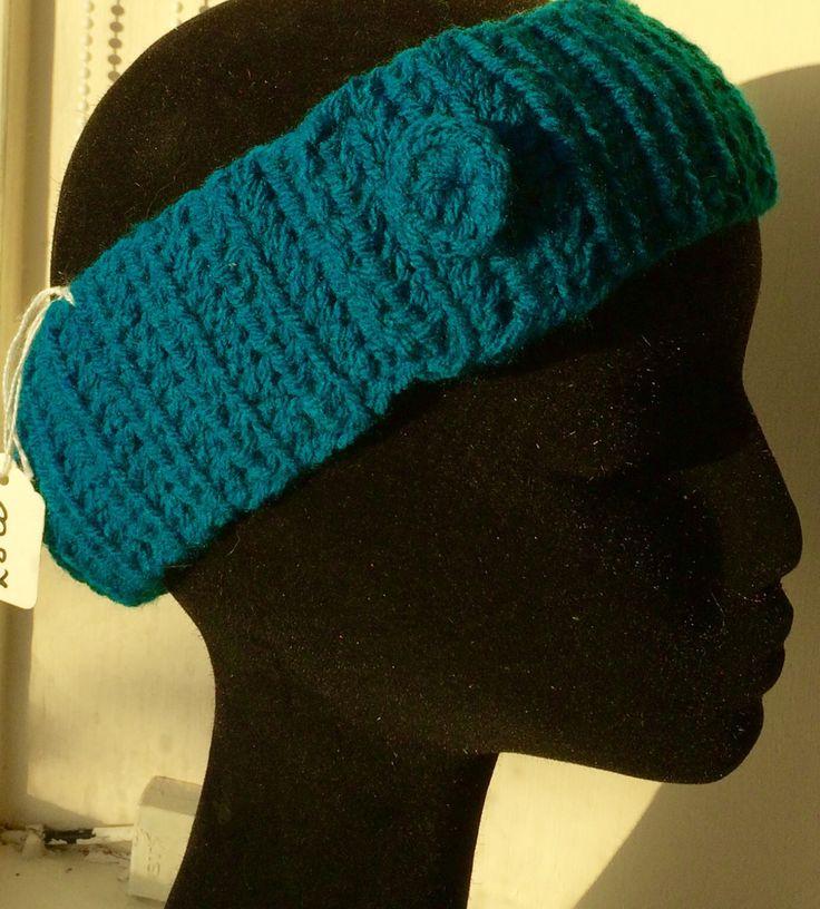 Crochet ear warmers with crochet button appliqué