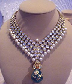 The word Kundan means highly refined gold, and a highly refined and pure form of molten gold is used.Kundan keshri is a traditional form of Indian gemstone jewellery involving a gem set with gold foil between the stones and its mount, usually for elaborate necklaces. The method is believed to have originated in the royal courts of Rajasthan and Gujarat. It is the oldest form of jewellery made and worn in India.It flourished under royal patronage during the Mughal era.