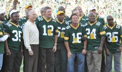 Coach Bart Starr and Lynn Dickey were joined by other Packers from the 1982 team when they were honored at the Packers' 2012 season-opener at Lambeau Field. They were joined by (players visible from the left) Del Rodgers (35), George Cumby (52), Ray Stachowitz (16), Johnny Gray (24), and Phillip Epps (85). Lynn Dickey: A Green Bay Packers great Green Bay Quarterback ~~~~Interesting READ~~~~ Raymond T. Rivard photograph