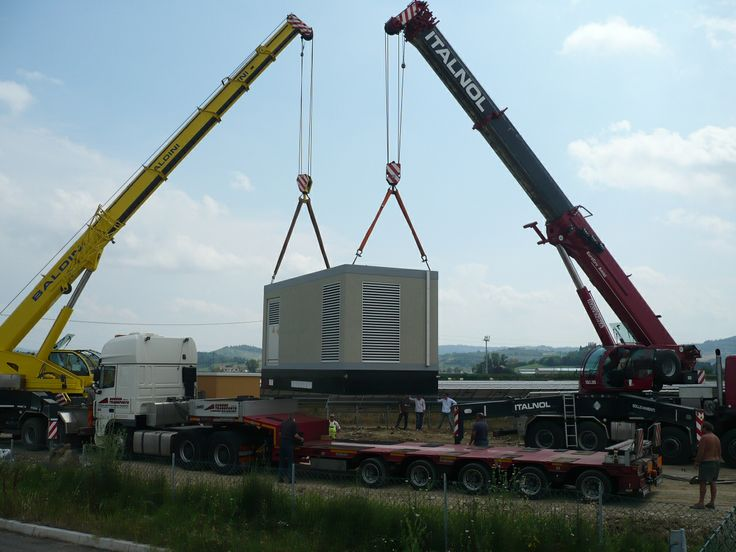 It takes two cranes to download a 60 ton inverter for a 2 MW solar farm - and takes nuts to drive them.