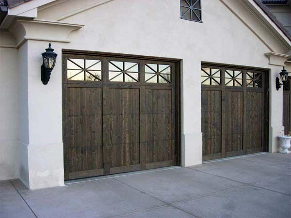 Garage door broken wooden garage door repair for Garage door repair lakewood