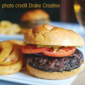 "Black and Blue Burger  A finely packed burger of aged, high quality beef sports a perfect charred exterior contrasting a tender pink center—the ""black-and-blue"" burger is a favorite of burger connoisseurs. Topped off with your personal favorites and sandwiched in a soft, fresh bun.  Barnaby's Steakhouse, New Paltz  845-255-2433  http://www.visitvortex.com/magazine/summer2012-burger-for-everyone"