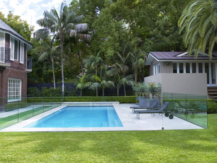 Pool with Howea forsteriana in background