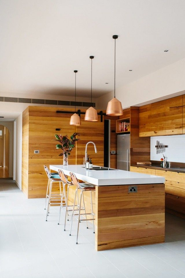 Australian design firm Altereco is behind this stunning and warm Melbourne abode. Filled with a sharp and distinctive juxtaposition of warm woods and cool metallics, it seamlessly marries...