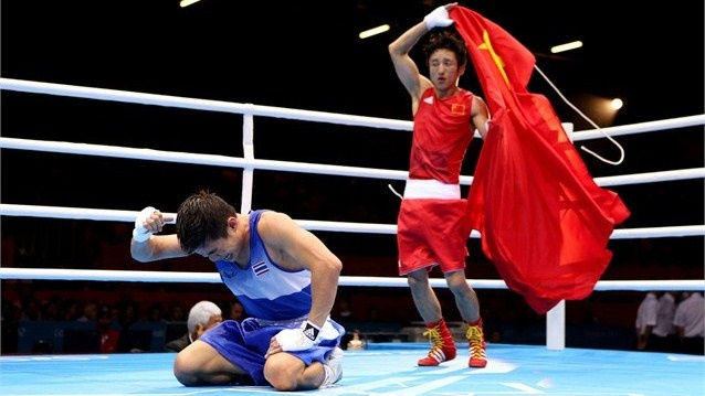 Zou Shiming celebrates winning gold in the men's Light Fly Weight final on Day 15 at London 2012.