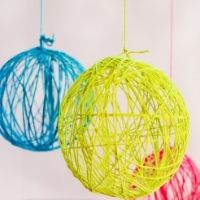 Hollow balls of yarn hung from the ceiling