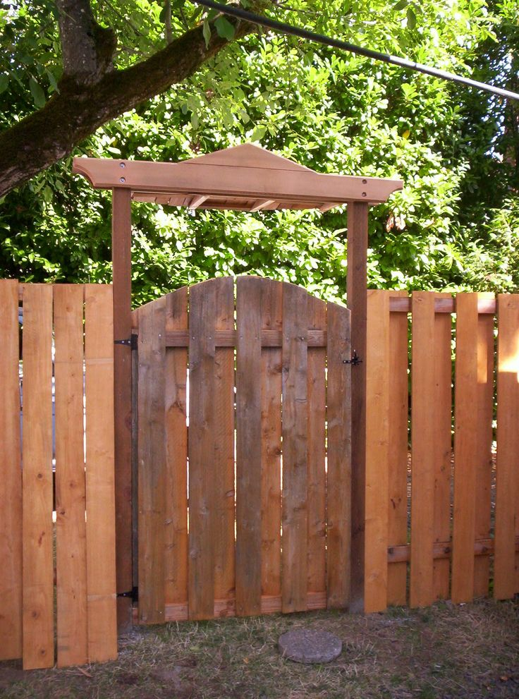 Arbor gates cedar gate with flame motif constructed for Fence with arbor