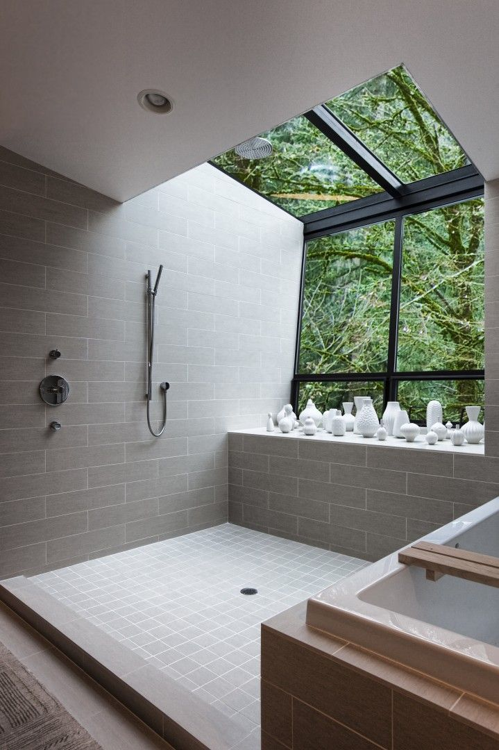 Light grey subway tile. Open shower. With a window view.