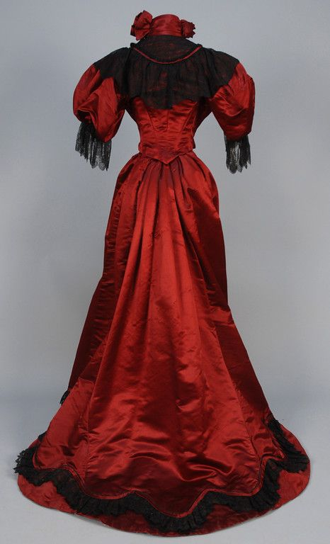 TRAINED SATIN and LACE EVENING DRESS, c. 1890.