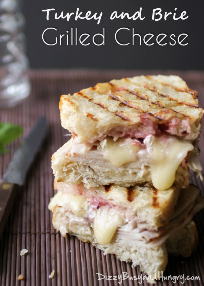 Turkey and Brie Grilled Cheese | DizzyBusyandHungry.com - Creamy brie, roasted turkey breast, and a cranberry spread stuffed between two pieces of sourdough bread and grilled until crispy. #grilledcheese #brie #turkey