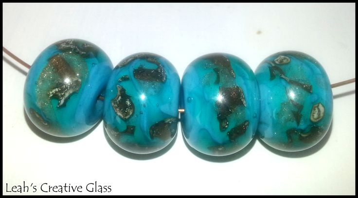 Ocean Blue with swipes of Silvered Ivory, Intense Blue & gold stone, melted flat then encased in clear for added depth.