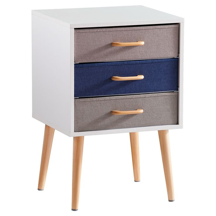 Drip sandcastles run through your fingers and pelicans flutter the sea breeze across your face with this adaptable accent piece. Colorblocked pop of denim blue, gray, and taupe peeps out of a white shell, and natural midcentury modern spindle legs create airy architecture. Perky wood handles smile on the spacious, removable drawers. Slide them out and have a framed shelf for oversized books, travel games, or dog treats; keep them and have a tidy spot for magazines, office supplies, or media…