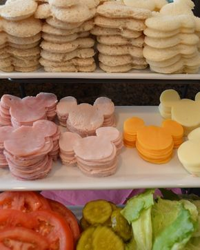 Micky Mouse shaped sandwich parts. The sandwiches are just made by using a Mickey Mouse cookie cutter to cut white bread, ham and turkey slices and cheese. :D