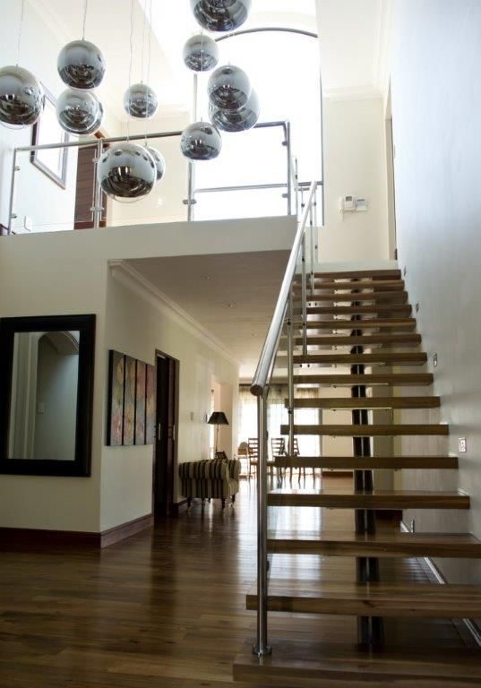 custom mild steel staircase, timber treads and stainless steel and glass balustrades