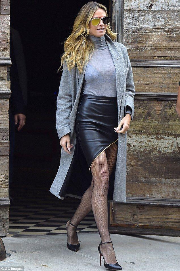 Heidi Klum showcases long toned legs in fishnets and ...