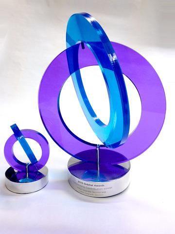 Multicoloured custom cut interlocking acrylic award  The spectacular acrylic award plays with the brand in a unique and impactful way.  Two pieces of custom-tinted acrylic intertwine to create a bespoke award that is thoughtful and original.   Mounted on a polished aluminium base the award captures and celebrates achievement. Click on the link in image to view more.