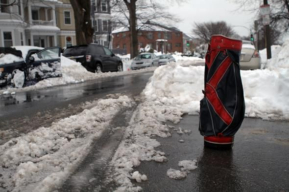 Even if the golf courses are closed there's still a use for a golf bag in Southie, where it was used as a parking spot saver last winter.