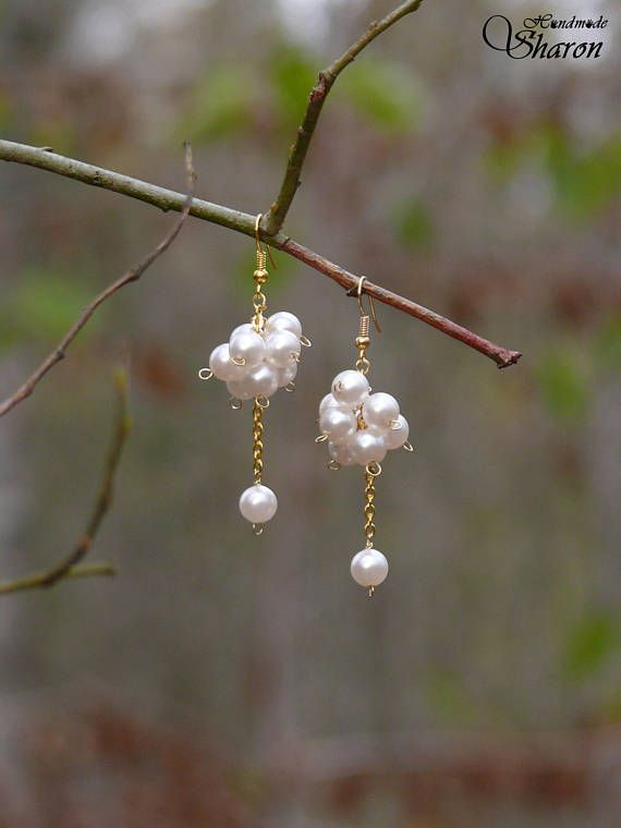 White pearl gold cluster earrings
