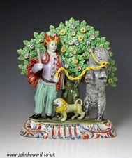 Staffordshire pottery pearlware bocage figure group of a troubador with lion and bear - OnlineGalleries.com