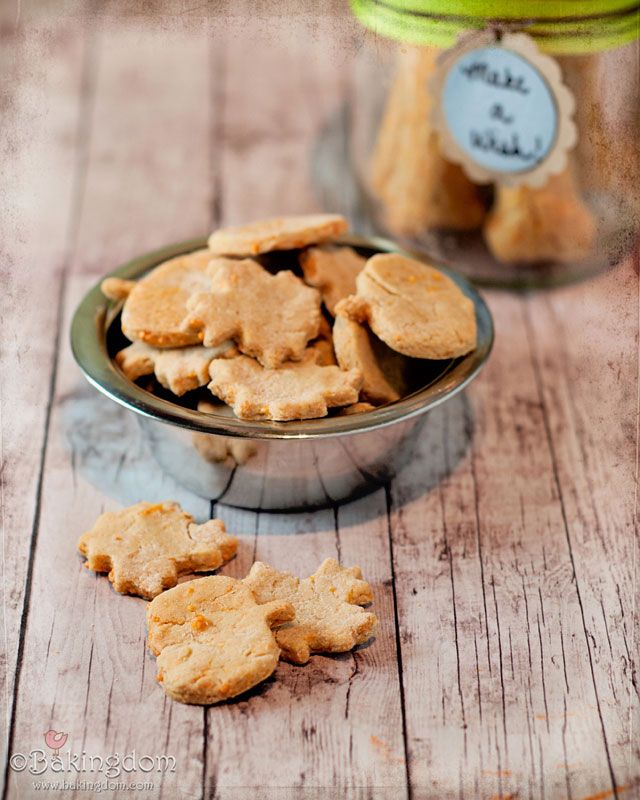 Cheesy Dog Treats  1 1/2 cups (240 grams) brown rice flour  1 1/2 cups (135 grams) oat flour  3/4 cup shredded cheddar cheese  3/4 cups shredded parmesan, or similar, cheese  1 egg  1 cup (250 ml) water or chicken broth    Preheat oven to 350 degrees (180 C).