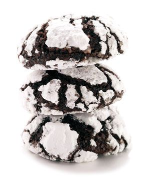 Chocolate Crinkles 1 1/4 cups all-purpose flour, spooned and leveled 3/4 cup unsweetened cocoa powder (preferably Dutch process) 1 1/2 teaspoons baking powder 1/4 teaspoon salt 1/2 cup (1 stick) unsalted butter, at room temperature 1 cup light brown sugar 2 large eggs 1/4 cup confectioners' sugar